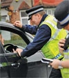 A Surrey police officer talks to a motorist